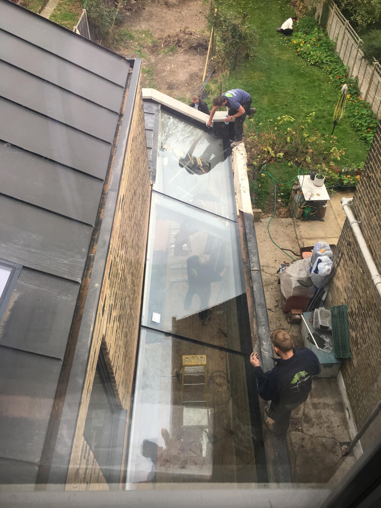 Frameless Glass infill roof extension